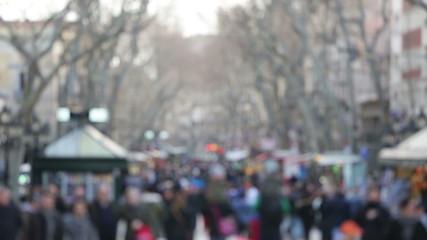 People walking background in Barcelona, La Rambla