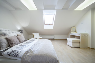 Double bed in bright bedroom