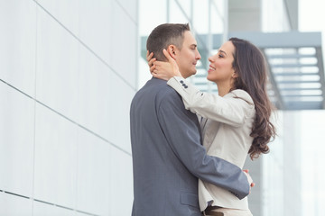 Portrait of affectionate young couple of business people