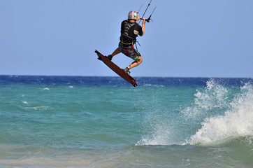 Kitesurfer with helmet  jumping