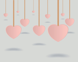 Hollow hearts hanging from ropes