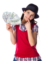 Dreaming girl with money in hands