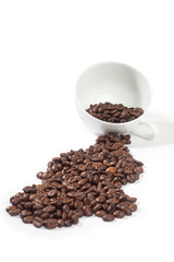 Coffee beans pouring out from a cup