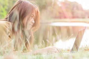women smile feel happy use laptop computer outdoor