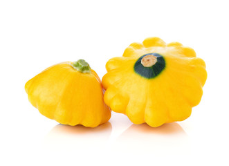 Yellow zucchini squash isolated on white background