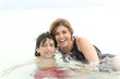 Hispanic mother and son enjoying tropical beach
