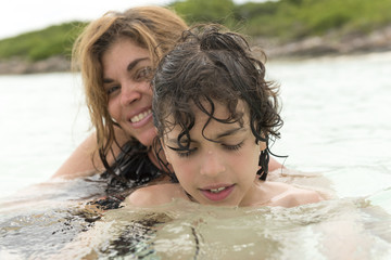 Single mother and son in a tropical beach