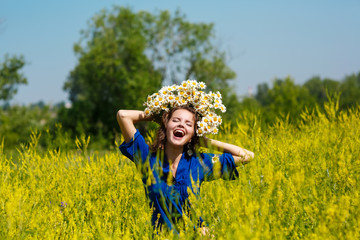 young sexy girl with flowers in the field