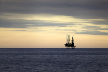 Gas platform at sunset