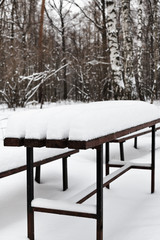 snow-covered table in city park