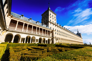 Royal Palace  in sunny autumn day from garden.  El Escorial