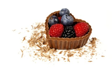 Heart shaped chocolate dessert cup filled with fresh berries