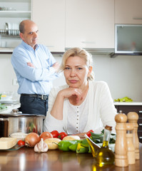 Senior couple conflicted at kitchen
