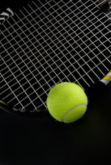 Green Tennis Ball with Racquet Dark Background