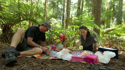 amily having a picnic in Redwood Forest Rotorua New Zealand