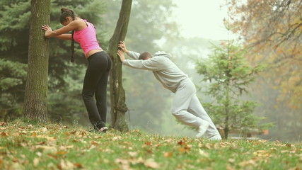 Couple stretching together