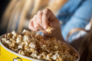 Girl Eating Popcorn In Cinema Theater