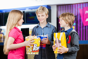 Siblings Holding Snacks At Cinema