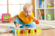 Leinwanddruck Bild - child toddler playing wooden toys at home