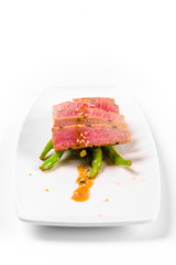 Tuna salad and asparagus on a white plate