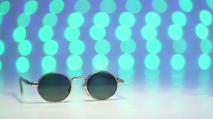 Retro sunglasses as travel concept on blurry colorful background