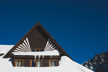 Wooden house in the winter mountain