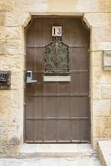 Brown door with number 13 in old city Jerusalem