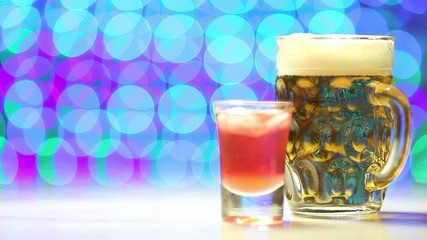 Beer and shot on blurry background as celebration concept