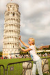 Leaning tower of Pisa and Young Woman, Italy.