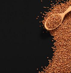 Wooden spoon with buckwheat groats