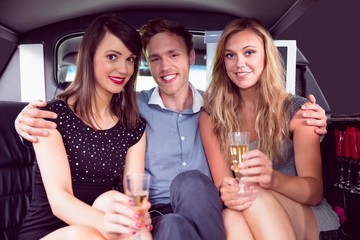 Pretty girls with ladies man in the limousine