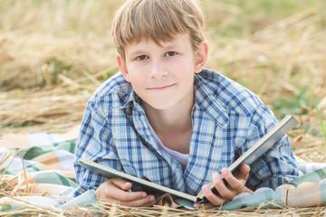 Teenage boy reading big book