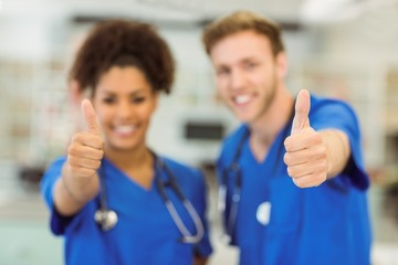 Young medical students showing thumbs up