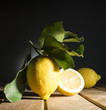 Lemon with leaves on the wooden table