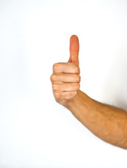 Male hand giving a thumbs up gesture
