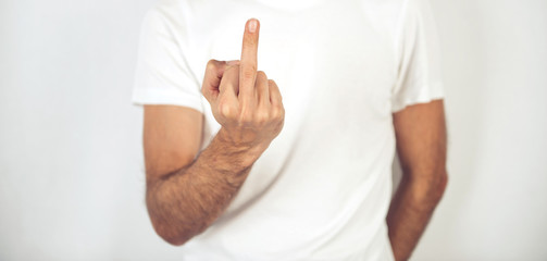 Man making a rude gesture with his middle finger