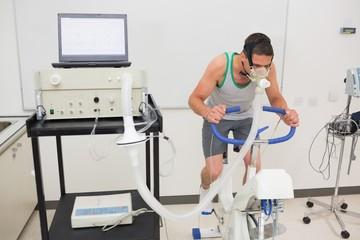Man doing fitness test on exercise bike