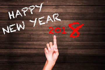 Happy New Year word on wooden background
