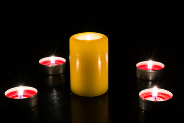 Candles are lit on the table, dark background