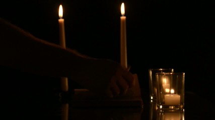 Candles flickering in low light.