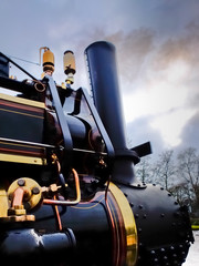 old steam engine with polished brass