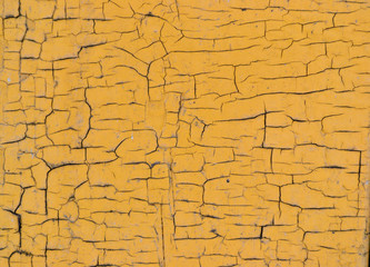 cracked wooden surface yellow background