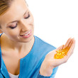 Woman with Omega 3 fish oil capsule