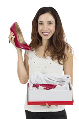 Woman happy with red shoes as a gift