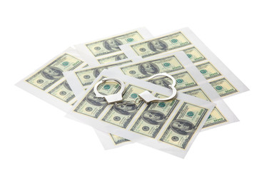 Printed sheets with dollars and handcuffs.