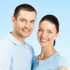 Portrait of young smiling amorous couple