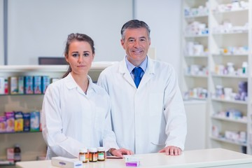 Pharmacist and his trainee looking at the camera