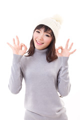 happy woman giving ok hand sign, fall or winter dress