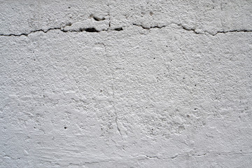 A texture of a white concrete wall.