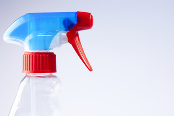 Blue/Red spray bottle nozzle close-up